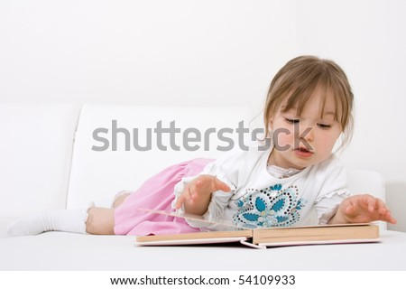 sweet happy little girl reading book - stock photo