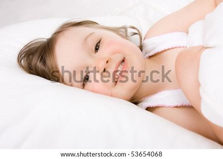 sweet happy little girl sleeping - stock photo