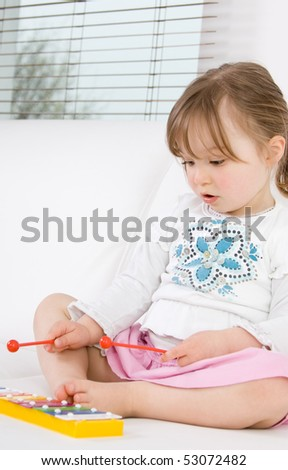 sweet happy little girl with instrument