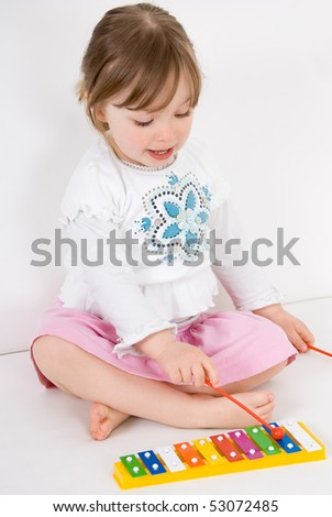 sweet happy little girl with instrument - stock photo