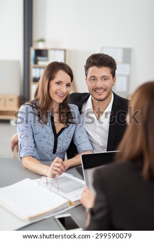 Sweet Happy Young Professional Couple Having a Meeting with a Financial Agent for Investments Inside the Office. - stock photo