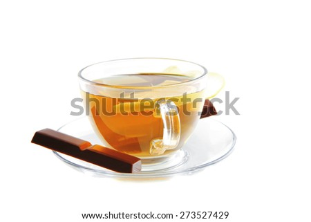 sweet health dessert - light green tea with lemon and chocolate strips isolated over white background - stock photo