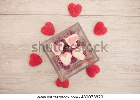 Sweet hearts on a gray wooden background