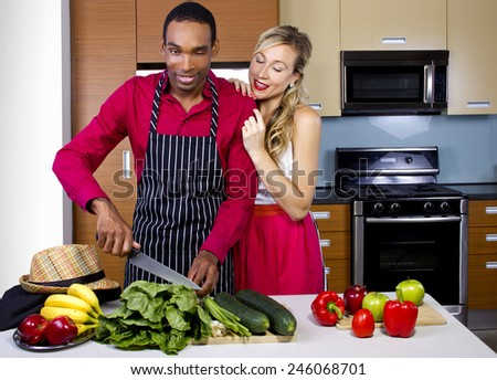 sweet helpful boyfriend cooking for girlfriend at home