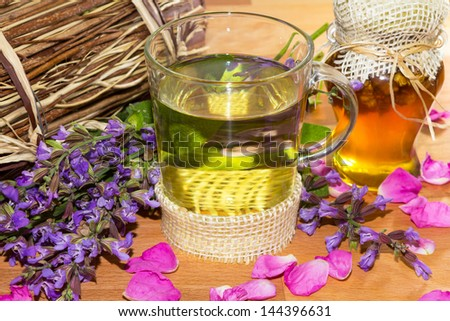 Sweet herbal tea or infusion with honey and sage for cold winter days, helps to prevent to prevent sore throat.t - stock photo