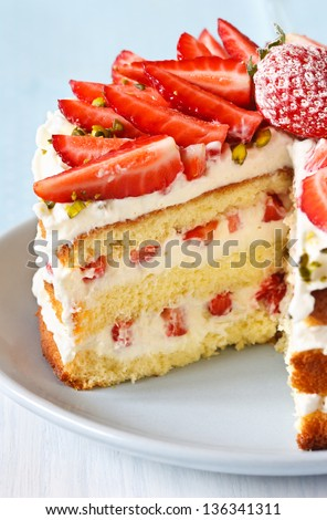 Sweet homemade cake with strawberry and whipped cream close up. - stock photo