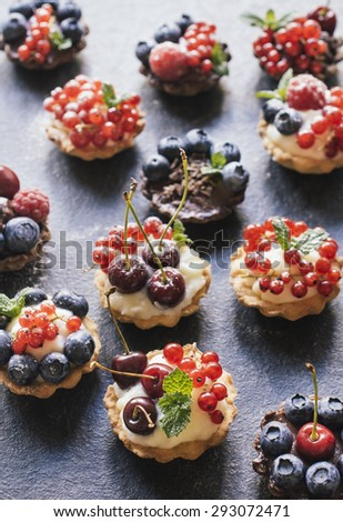 Sweet homemade mini tart cake with pudding and berry fruits,selective focus - stock photo