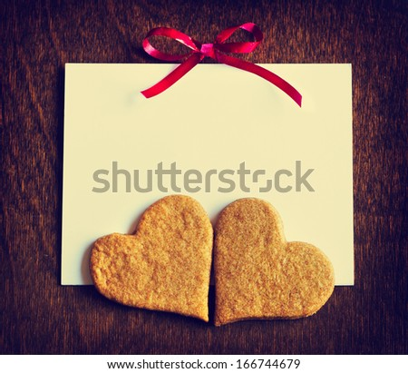 Sweet homemade sugar cookies over wooden table/ Valentine's day background/ Heart shaped cookies with copy space/ I love you card