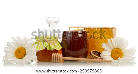 Sweet honey and honeycomb with flowers and dipper - stock photo
