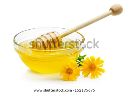Sweet honey in glass bowl isolated with wooden dipper on white - stock photo