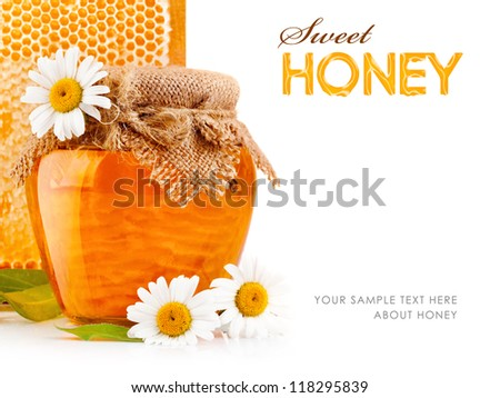 sweet honey in glass jars with flowers isolated on white background - stock photo