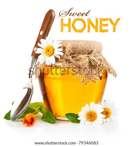 sweet honey in glass jars with spoon and flowers isolated on white background - stock photo