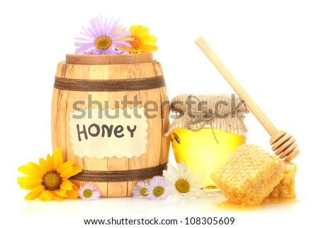 Sweet honey in jar and barrel with honeycomb, wooden drizzler and flowers isolated on white
