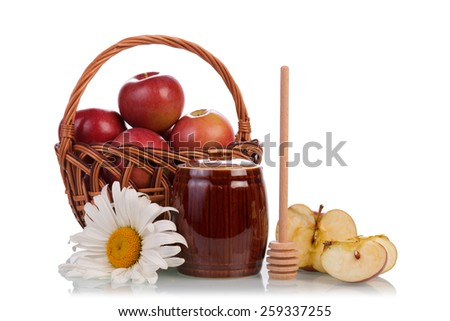 Sweet honey in jar with basket of apples and flower - stock photo