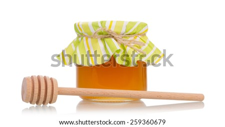 Sweet honey with dipper on white background - stock photo