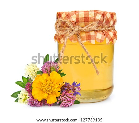 Sweet honey with flowers closeup on white isolated - stock photo