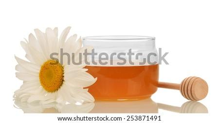 Sweet honey with honey dipper and flower on white background - stock photo