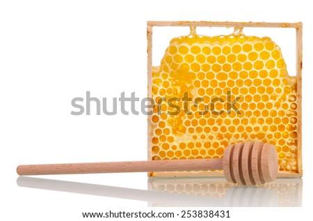 Sweet honey with honey dipper on white background - stock photo
