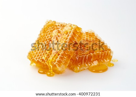 Sweet honeycomb, isolated on white - stock photo