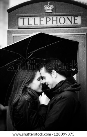 Sweet honeymoon couple in London famous site. - stock photo