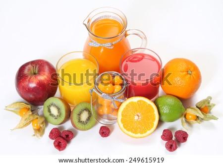 sweet juice and fruits on white - stock photo