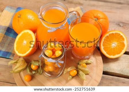 sweet juice and fruits on wood - stock photo
