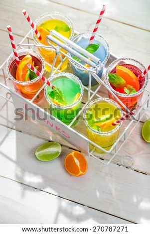 Sweet lemonade with straw and fruits