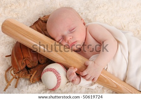 Sweet Little Baby Boy Holding a Baseball Bat With Glove and Ball - stock photo