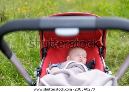Sweet little baby boy sleeping in stroller  - stock photo