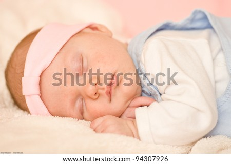 Sweet little baby is sleeping with hands