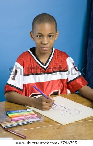 Sweet little boy drawing a picture