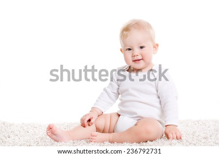 Sweet little boy sitting. Baby child with various funny poses and hands gestures isolated on white with copy space. Little boy lying on stomach and looking at camera over white background - stock photo