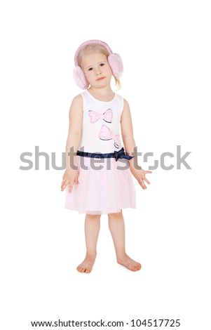 sweet little child in the delicate pink dress and fur headphones