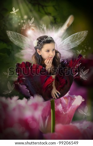 Sweet little fairy in a blossom red tulip - stock photo