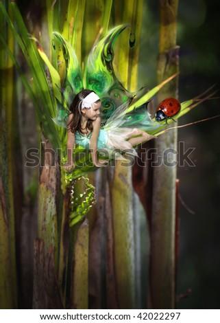 Sweet little fairy in the garden - stock photo