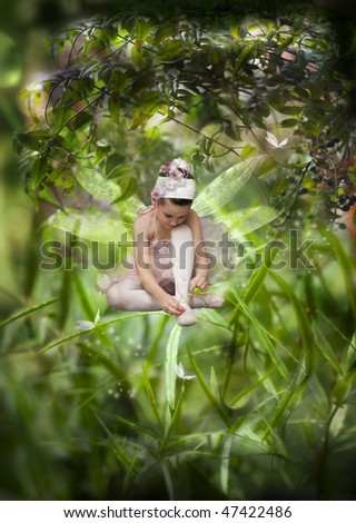 Sweet little fairy in the grass - stock photo