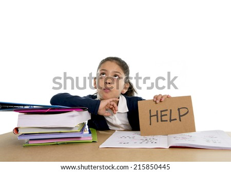 sweet little female latin child studying on desk asking for help in stress with a tired face expression in children education and back to school concept isolated on white background - stock photo