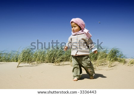 sweet little girl at the beach - stock photo