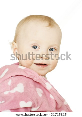 sweet little girl in pink coat smiling with two teeth, isolated on white