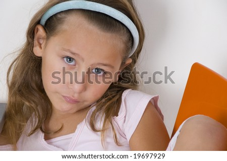 sweet little girl looking at the camera - stock photo