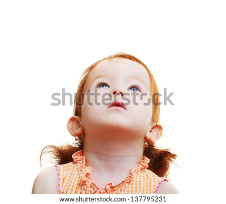 sweet Little girl looking up to the copy space area - stock photo