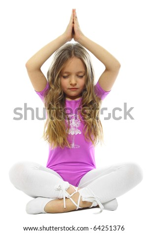 sweet little girl meditating isolated on white - stock photo