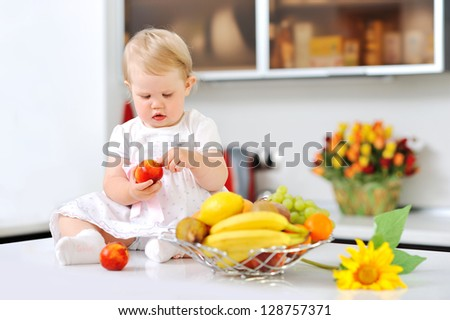Sweet little girl on a kitchen