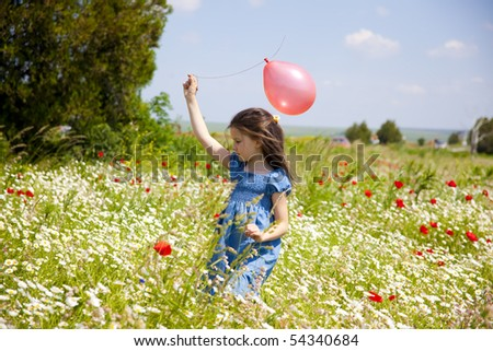 Sweet little girl on the beauty field with wild flowers - stock photo