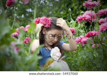 Sweet little girl on the field with poppies - stock photo