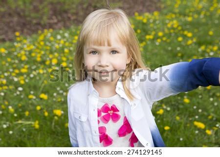 Sweet little girl outdoors - stock photo