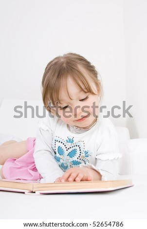 sweet little girl reading book - stock photo