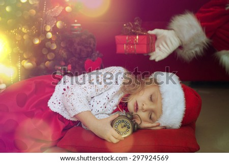 Sweet little girl sleeps in Santa caps - stock photo