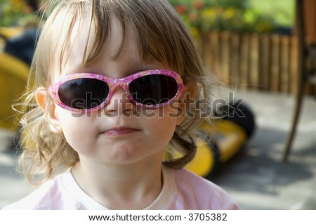 sweet, little girl wearing funny, pink sunglasses. cute - stock photo