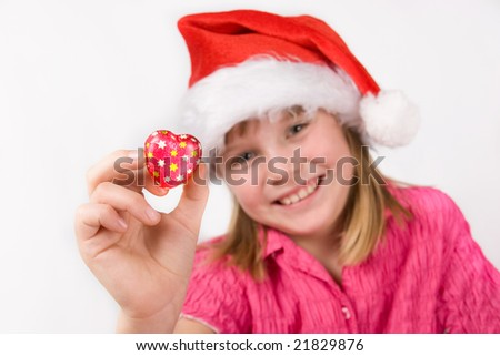 Sweet little girl with fine red candy in hand - stock photo